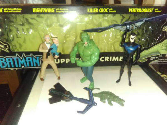 "Image for Puppets of Crime 5-Pack:""Includes Nightwing (with shield and grappling hook launcher), Killer Croc (with crocodile) and Ventriloquist (with Scarface)! 5"""" scale.""(missing:Batman (with removable cape, mask and gauntlets)"