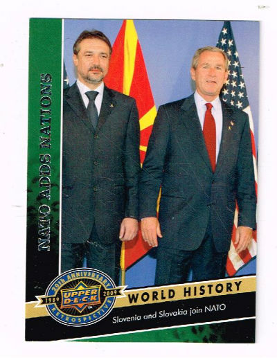 Image for War monger and international criminal;George Bush welcomes Slovena and Slovakia into Nato 2004,March 4th